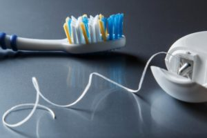 floss and toothbrush