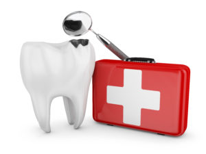 A model of a tooth next to an emergency kit