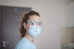 Woman wearing medical mask during dental emergencies.