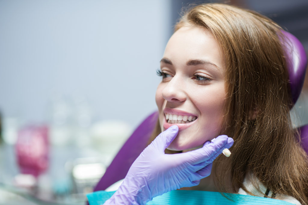 Woman smiling with CEREC crown in Ridgefield